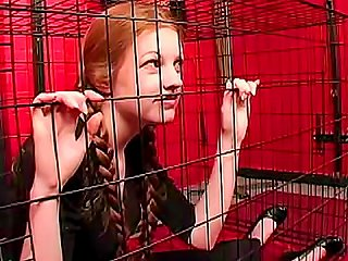 Teen Redhead In Pigtails Caged By Mistress